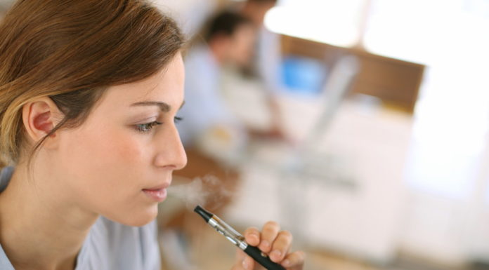 woman smoking with e-cigarettes