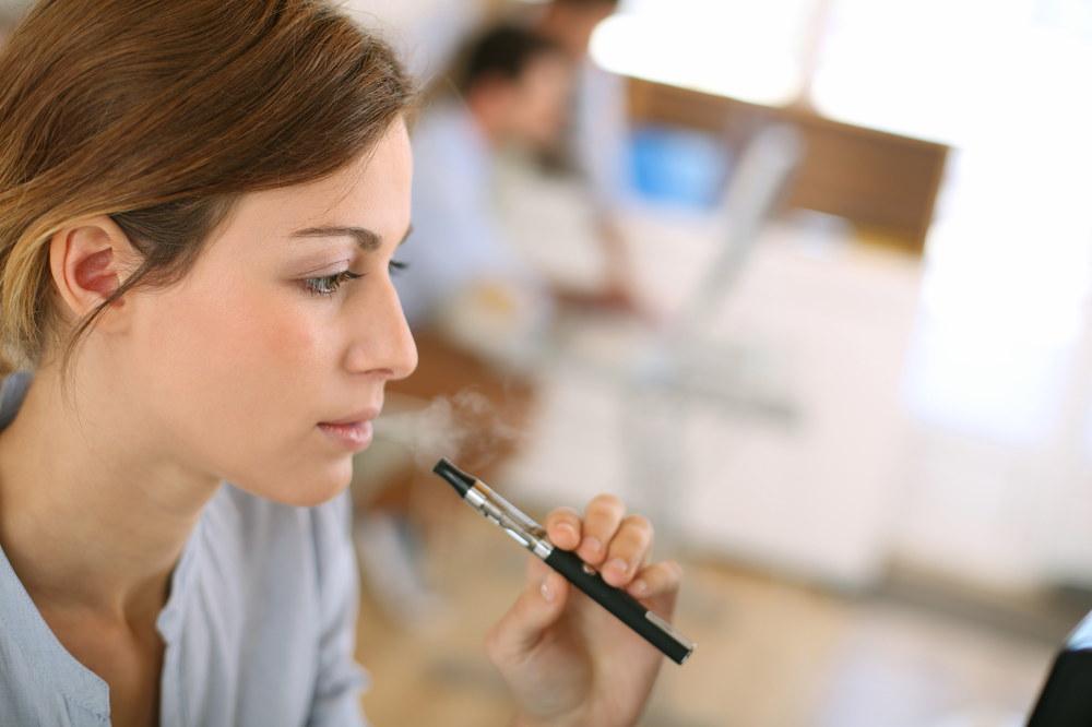 woman smoking with e-cigarette