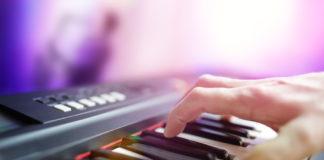 Pianist musician - playing electronic piano